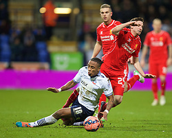 BOLTON, ENGLAND - Wednesday, February 4, 2015: Liverpool's Joe Allen is fouled by Bolton Wanderers' Neil Danns, who was subsequently sent off, during the FA Cup 4th Round Replay match at the Reebok Stadium. (Pic by David Rawcliffe/Propaganda)