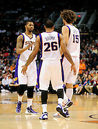Feb. 4, 2012; Phoenix, AZ, USA; Phoenix Suns forward Markieff Morris (11) , guard Shannon Brown (26) and center Robin Lopez (15) react on the court while playing against the Charlotte Bobcats during the second half at the US Airways Center. The Suns defeated the Bobcats 95 - 89. Mandatory Credit: Jennifer Stewart-US PRESSWIRE.
