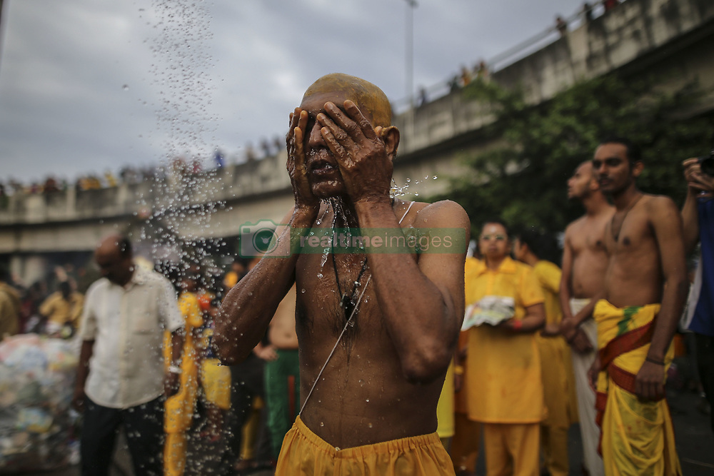 January 31, 2018 - Batu Caves, Malaysia - A hindu devotee prays before making his way towards the Batu Caves temple during the Thaipusam Hindu festival on January 31, 2018 in Batu Caves, Malaysia. (Credit Image: © Mat Zain/NurPhoto via ZUMA Press)