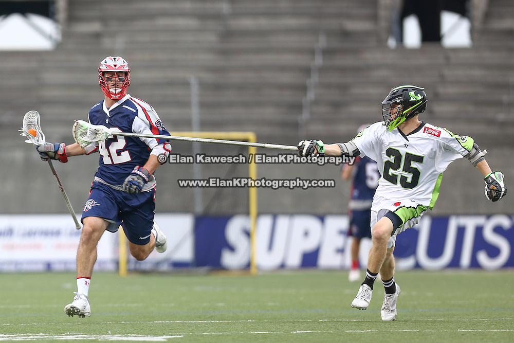Brian Karalunas #25 of the New York Lizards tries to get the ball from a member of the Boston Cannons during the game at Harvard Stadium on July 19, 2014 in Boston, Massachusetts. (Photo by Elan Kawesch)