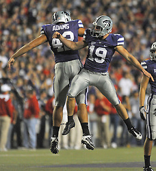 Oct 07, 2010; Manhattan, KS, USA; Kansas State Wildcats kicker Josh Cherry (19) and center Corey Adams (42) celebrate after Cherry kicks a field goal in the second quarter against the Nebraska Cornhuskers at Bill Snyder Family Stadium. Mandatory Credit: Denny Medley-US PRESSWIRE