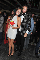 MARC JACQUES BURTON and ELLIE SHARPE at the launch party for the new nightclub Tonteria, 7-12 Sloane Square, London on 25th October 2012.