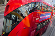 Seen from another bus, the curved design at the rear of a new Routemaster London bus travelling on the number 12 route through the capital, on 12th September 2017, in London, England.