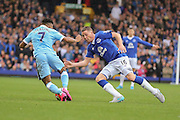 midfielder Raheem Sterling takes on midfielder James McCarthy during the Barclays Premier League match between Everton and Manchester City at Goodison Park, Liverpool, England on 23 August 2015. Photo by Simon Davies.