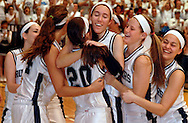 6 MARCH 2010 -- ST. CHARLES, Mo. -- St. Dominic HIgh School basketball players mob teammate Jennifer Rocha (center, with black arm sleeve)) after the Crusaders defeated Miller Career Academy  during MSHSAA GIrls' Class 4 basketball quarterfinals at Lindenwood University Saturday, March 6, 2010. Photo (c) copyright by Sid Hastings.