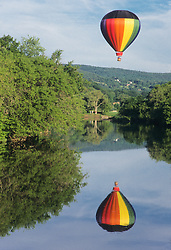 North America, United States, Vermont, Queechee, hot air balloon and reflection in Ottaqueechee River during balloon festival held annually in June