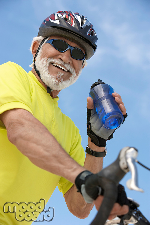 Man Refreshing After a Bicycle Ride