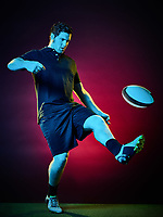 one caucasian rugby man player on colorful black background