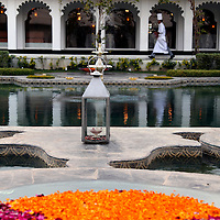 Asia, India, Udaipur. Floating flower bowls add color to the courtyard pools of Taj Lake Palace Hotel.