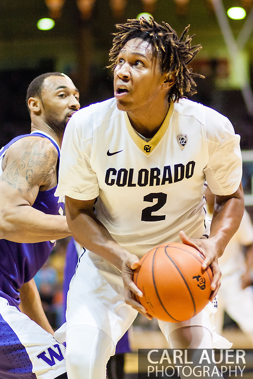 February 9th, 2014:  Colorado Buffaloes sophomore forward Xavier Johnson (2) pump fakes a shot in the second half of the NCAA Basketball game between the Washington Huskies and the University of Colorado Buffaloes at the Coors Events Center in Boulder, Colorado