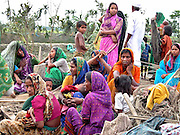 Villagers whose properties were destroyed in a storm look on at Nandia village, about 300 kilometers (186 miles) from Gauhati, capital of northeastern Indian state of Assam, Wednesday, April 23, 2003.  A cyclone swept through Assam state, killing at least 36 people and injuring 1.500 others, police said Wednesday. (AP Photo/Shib Shankar Chatterjee)