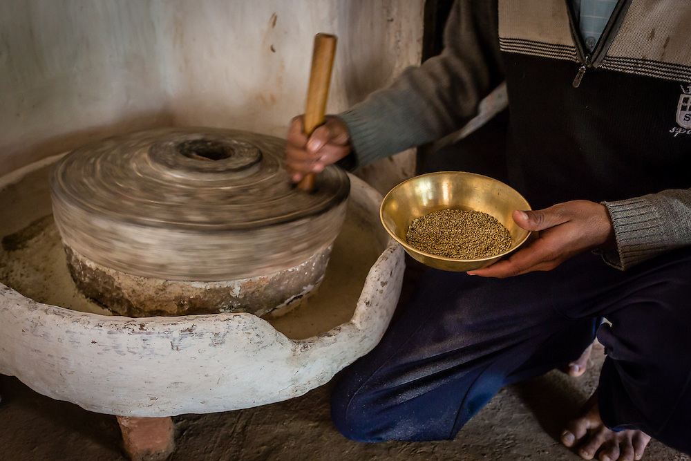Grain is ground into flour using a grinding wheel. This flour is then used for chapati, the ubiquitous thin indian bread, that accompanies every meal.