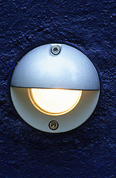 Downlighter mounted onto blue painted wall