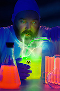 A mad scientist has an experiment go horribly wrong as electrical bolts shoot up out of a beaker and test tube.Black light
