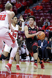 05 November 2017:  Jake Reinhart drives to the lane pursued by Madison Williams during aLewis College Flyers and Illinois State Redbirds in Redbird Arena, Normal IL