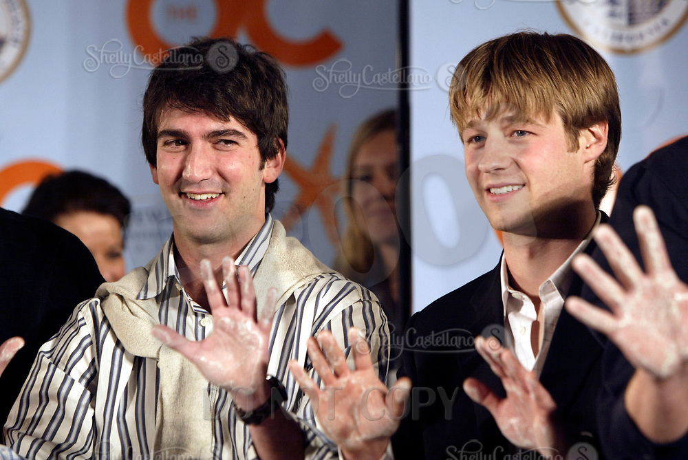 Oct 28, 2004; Newport Beach, CA, USA; Holding thier wet hands up high, Cast Member BENJAMIN MCKENZIE & Creator JOSH SCHWARTZ on the FOX hit TV show 'The OC' visited the Balboa Penninsula in Newport Beach to get a Key to the City and be immortalized in cement with thier hand prints to be placed at the enterance to the Historic Balboa Pavillion.  Mandatory Credit: Photo by Shelly Castellano/ZUMA Press.