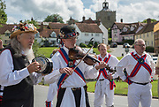 Thaxted Morris Weekend 3-4 June 2017<br /> A meeting of member clubs of the Morris Ring celebrating the 90th anniversary of the founding of the Thaxted Morris Dancing side or team in Thaxted, North West Essex, England UK. <br /> Members of Chalice side from Western Super Mare Dancing at Finchingfield Essex<br /> Hundred of Morris dancers from the UK and this year the Silkeborg side from Denmark spend most of Saturday dance outside pubs in nearby villages where much beer is consumed. In the late afternoon all the sides congregate in Thaxted where massed dancing is perfomed along Town Street. As darkness falls across Thaxted the spell binding Abbots Bromley Horn Dance is performed to the sound of a solo violin in the dark.