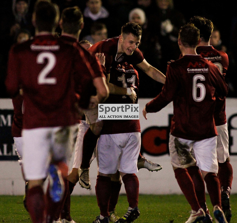Linlithgow players rush to celebrate with Ryan Baptie(center) after his 40 yards wonder goal put his side 2-1 ahead on the night against Wick in the Scottish Cup tie at Prestonfield Linlithgow