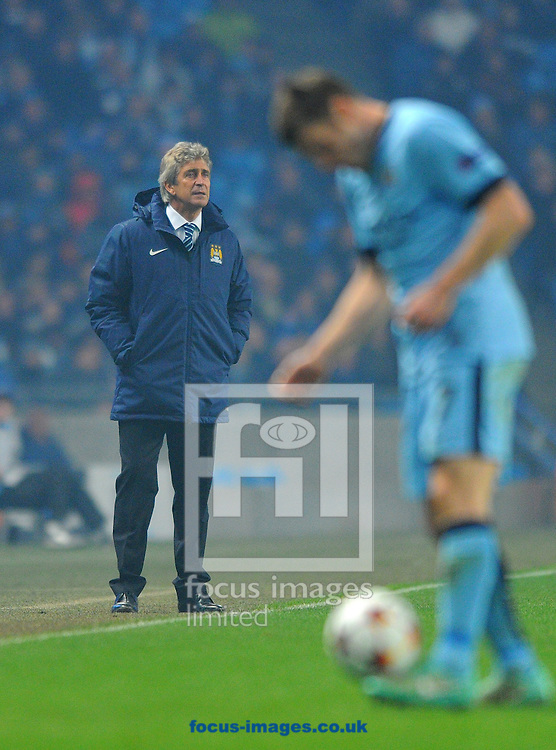 Manchester City manager Manuel Pellegrini (left) during the UEFA Champions League match at the Etihad Stadium, Manchester<br /> Picture by Greg Kwasnik/Focus Images Ltd +44 7902 021456<br /> 05/11/2014
