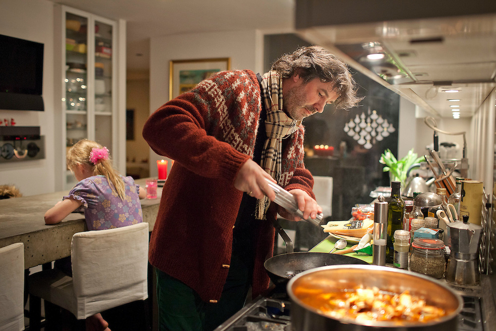 Kjartan Ólafsson prepares ptarmigan, a small arctic grouse and traditional Icelandic Christmas dish, at his sister-in-law, Þorgerður Gunnarsdóttir's home in Reyjkjavik, Iceland on December 23, 2013.