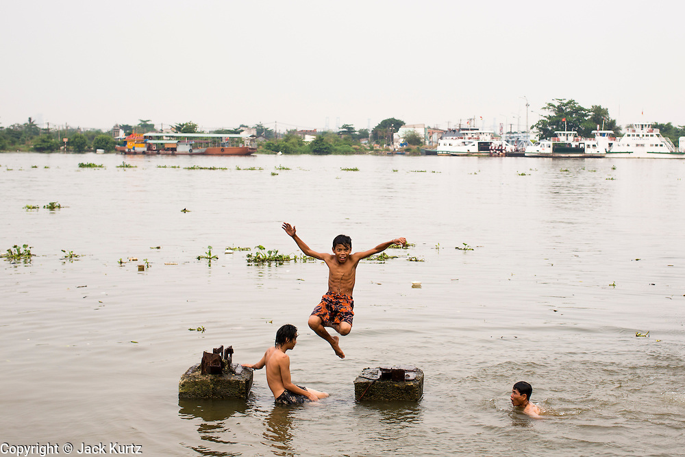 27 MARCH 2012 - HO CHI MINH CITY, VIETNAM:   Teenagers swim in the Saigon River in Ho Chi Minh City, Vietnam. Ho Chi Minh City, which used to be known as Saigon, is the largest city in Vietnam and the commercial hub of southern Vietnam.     PHOTO BY JACK KURTZ