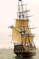 """The """"Bounty"""" sailing off the waters of Ogden Point prepares to engage in a """"mock"""" cannon battle. Tall ship's festival, Victoria, Vancouver Island, British Columbia, Canada."""