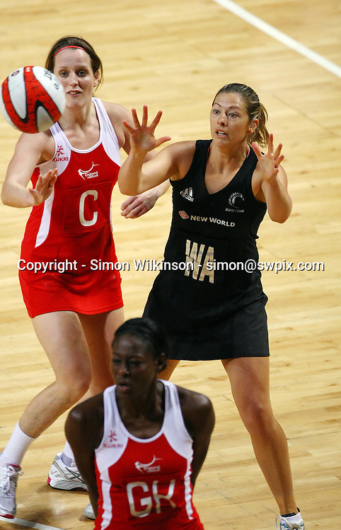 PICTURE BY VAUGHN RIDLEY/SWPIX.COM...Netball - International Netball Series - England v New Zealand - MEN Arena, Manchester, England - 15/01/11...New Zealand's Anna Thompson and England's Sara Bayman.