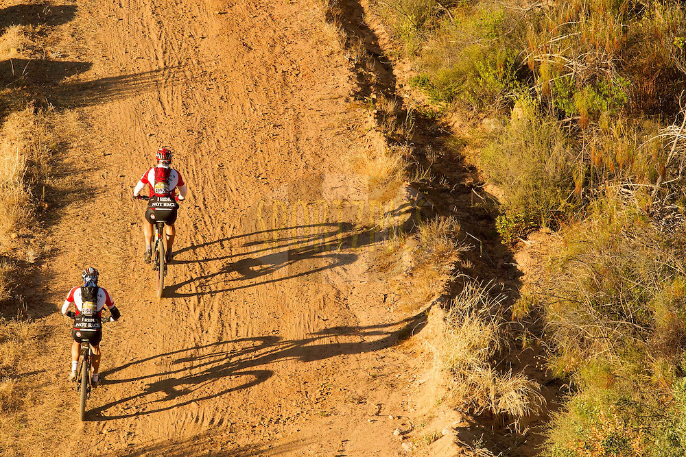 Tielman Myburgh and Dusan Navratil climb the old Piekenierskloof Pass during stage 1 of the 2013 Absa Cape Epic Mountain Bike stage race held from Citrusdal, South Africa on the 18 March 2013..Photo by Greg Beadle/Cape Epic/SPORTZPICS