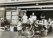 in front of the family grocery and liquor store Japan Yokosuka 1950s