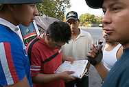 NEWS&GUIDE PHOTO / PRICE CHAMBERS.Each stop for gas gives the group another chance to study the map and double check their route. Gregorio Cruz, El Don as Cesar calls him, inspects the atlas as the others look to him for an update. At 40 he is significantly older than the others plus he is the only one who has made the trip before.