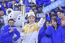 November 1, 2017 - Incheon, South Korea - South Korean speed skater LEE SANG-HWA carries the torch for the 2018 PyeongChang Winter Olympics on Incheon Bridge in Incheon. Lee Sang-hwa realized her dream of running in an Olympic torch relay on Wednesday, carrying the flame for next year's Winter Games on home ice. Lee, two-time reigning Olympic gold medalist in the women's 500m, ran as the 60th torchbearer for the 2018 PyeongChang Winter Games. The Olympic flame arrived at Incheon International Airport earlier Wednesday, having been lit and handed over to PyeongChang in Greece, and the torch relay got underway on Incheon Bridge, near the airport. (Credit Image: © Zuma via ZUMA Wire)