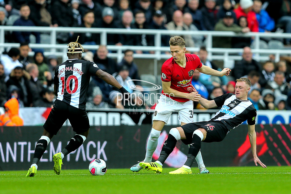 Sean Longstaff (#36) of Newcastle United slides in to win the ball from Nemanja Matic (#31) of Manchester United during the Premier League match between Newcastle United and Manchester United at St. James's Park, Newcastle, England on 6 October 2019.