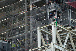 © Licensed to London News Pictures. 18/10/2019. LONDON, UK.  A climate activist from Extinction Rebellion scales the construction scaffolding of the Queen Elizabeth Tower in Westminster.  Parliament Square and the surrounding area has been brought to a standstill as police and emergency services assess the situation.  Photo credit: Stephen Chung/LNP
