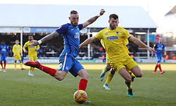 Marcus Maddison of Peterborough United in action with Jonathan Meades of AFC Wimbledon - Mandatory by-line: Joe Dent/JMP - 24/02/2018 - FOOTBALL - ABAX Stadium - Peterborough, England - Peterborough United v AFC Wimbledon - Sky Bet League One