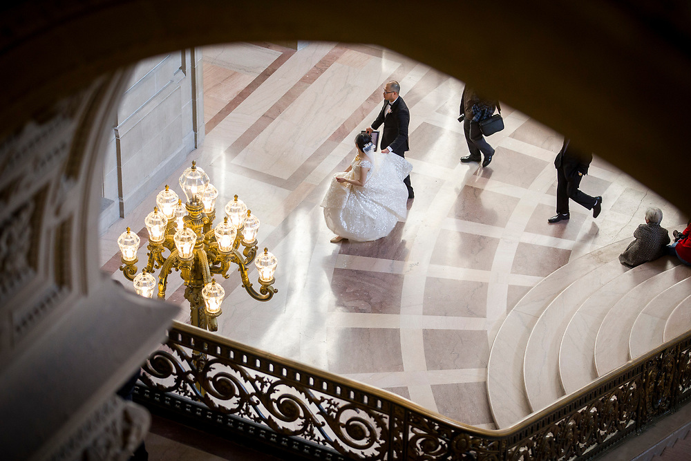 From left: Jiemi Yang and Sam Huang take wedding photos at City Hall on Tuesday, Dec. 12, 2017, in San Francisco, Calif.