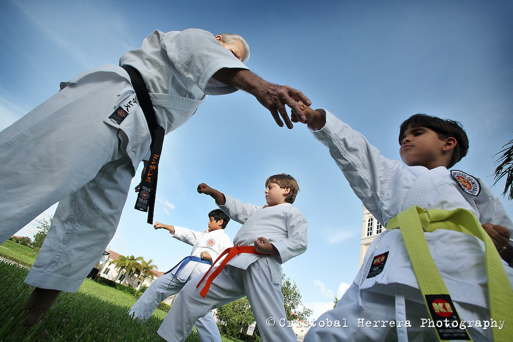 Karate coach Vicente Gonzalez, left, teaches Dylan Aleman, 5, during his training session at Sunset Lake Community Center on Monday July 6, 2009. Staff photo/Cristobal Herrera..