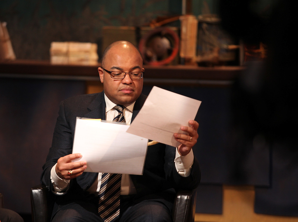 SportsCenter Special host Mike Tirico looks over notes during a break in the show in Indianapolis, Ind. Thursday February 2, 2012. .Photo by Chris Bergin