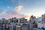 Early evening view of Manhattan cityscape from a balcony.
