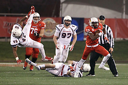 11 December 2015:  Christian Gibbs(12) slips away from David Herlocker and continues his journey up the field. NCAA FCS Quarter Final Football Playoff game between Richmond Spiders and Illinois State Redbirds at Hancock Stadium in Normal IL (Photo by Alan Look)