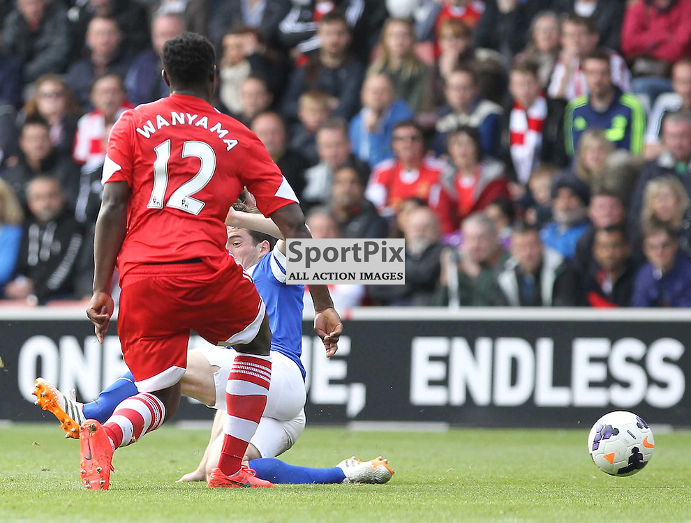 Everton's Leighton Baines slides in to tackle Southampton's Victor Wanyama during the Barclays Premiership match between Southampton FC and Everton FC, at the St Mary's Stadium, 26th April 2014 © Phil Duncan | SportPix.org.uk