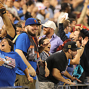 New York Mets fans celebrate as the New York Mets tie the ball game in the 11th during the New York Mets Vs Toronto Blue Jays MLB regular season baseball game at Citi Field, Queens, New York. USA. 15th June 2015. Photo Tim Clayton