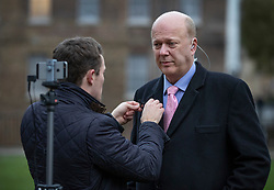 © Licensed to London News Pictures. 02/01/2019. London, UK. Transport Secretary Chris Grayling has a microphone attached as he gives interviews about today's rail fare increases. Photo credit: Peter Macdiarmid/LNP