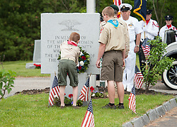 Members of Gilford Boy Scout Troop 243 place a wreath the Veteran's Memorial during Memorial Day ceremonies on Monday, May 29, 2017.  (Alan MacRae for the Laconia Daily Sun)