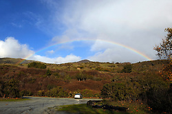 Both ends of a rainbow on a stormy December afternoon at Andrew Molera State Park.