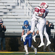 Smyrna defensive backs Jake Kaiser (20) and Marcus	Vass (15) celebrates a fourth down stop during the DIAA division one Football Championship game between Top-seeded Middletown (11-0) and second-seeded Smyrna (11-0) Saturday, Dec. 03, 2016 at Delaware Stadium in Newark.