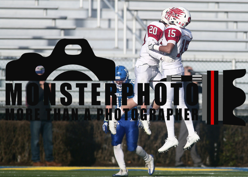 Smyrna defensive backs Jake Kaiser (20) and MarcusVass (15) celebrates a fourth down stop during the DIAA division one Football Championship game between Top-seeded Middletown (11-0) and second-seeded Smyrna (11-0) Saturday, Dec. 03, 2016 at Delaware Stadium in Newark.