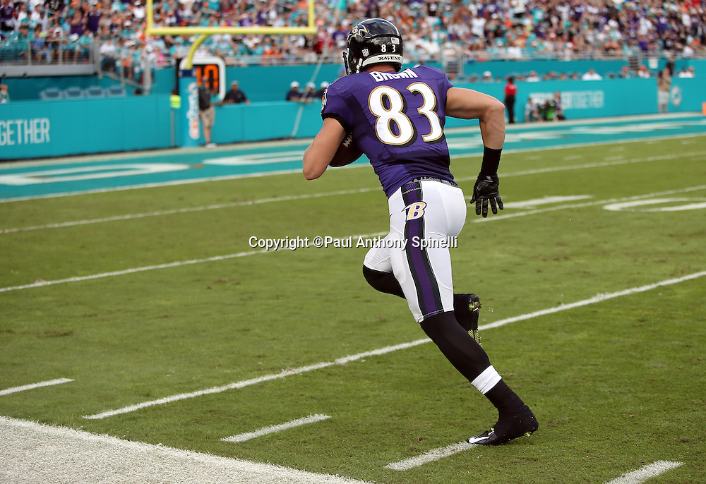 Baltimore Ravens wide receiver Daniel Brown (83) scores a first quarter touchdown that gets negated by a penalty during the 2015 week 13 regular season NFL football game against the Miami Dolphins on Sunday, Dec. 6, 2015 in Miami Gardens, Fla. The Dolphins won the game 15-13. (©Paul Anthony Spinelli)
