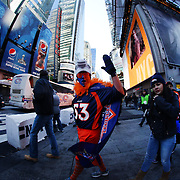 A Denver Broncos fan dressed in his teams colors during Super Bowl week activities in Times Square, New York, USA. 29th January 2014. Photo Tim Clayton