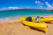 Kayaks on empty beach at Hanalei Bay, Island of Kauai, Hawaii