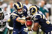 ST. LOUIS, MO - SEPTEMBER 11:   Sam Bradford #8 of the St. Louis Rams makes a hand off to Carnell Williams #33 during a game against the Philadelphia Eagles at the Edward Jones Dome on September 11, 2011 in St. Louis, Missouri.  The Eagles defeated the Rams 31 to 13.  (Photo by Wesley Hitt/Getty Images) *** Local Caption *** Sam Bradford; Carnell Williams